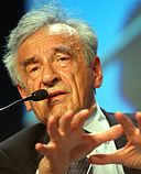 DAVOS,28JAN03 - Elie Wiesel, Professor of the Humanities, Boston University, USA speaks during the session '269 A New Agenda: Combining Efficiency and Human Dignity' at the 'Annual Meeting 2003' of the World Economic Forum in Davos/Switzerland, January 28, 2003. copyright by World Economic Forum swiss-image.ch/photo by Sebastian Derungs