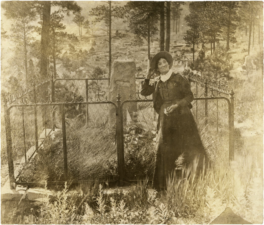 Calamity Jane at Wild Bill Hickok's Gravesite, Deadwood, Dakota Territory.