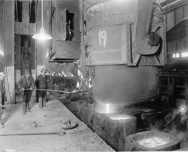 Steelworkers pouring molten steel