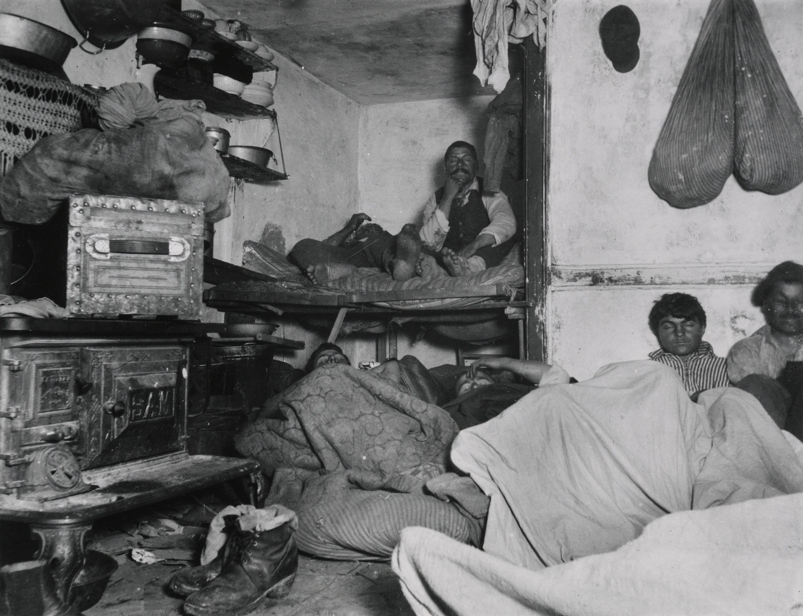 Tenement lodgers in a crowded room