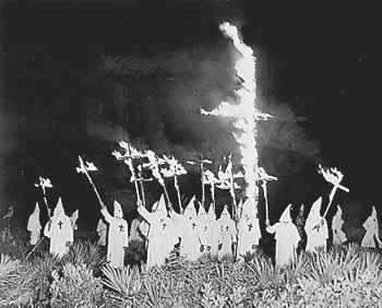 Klan night rally with burning crosses