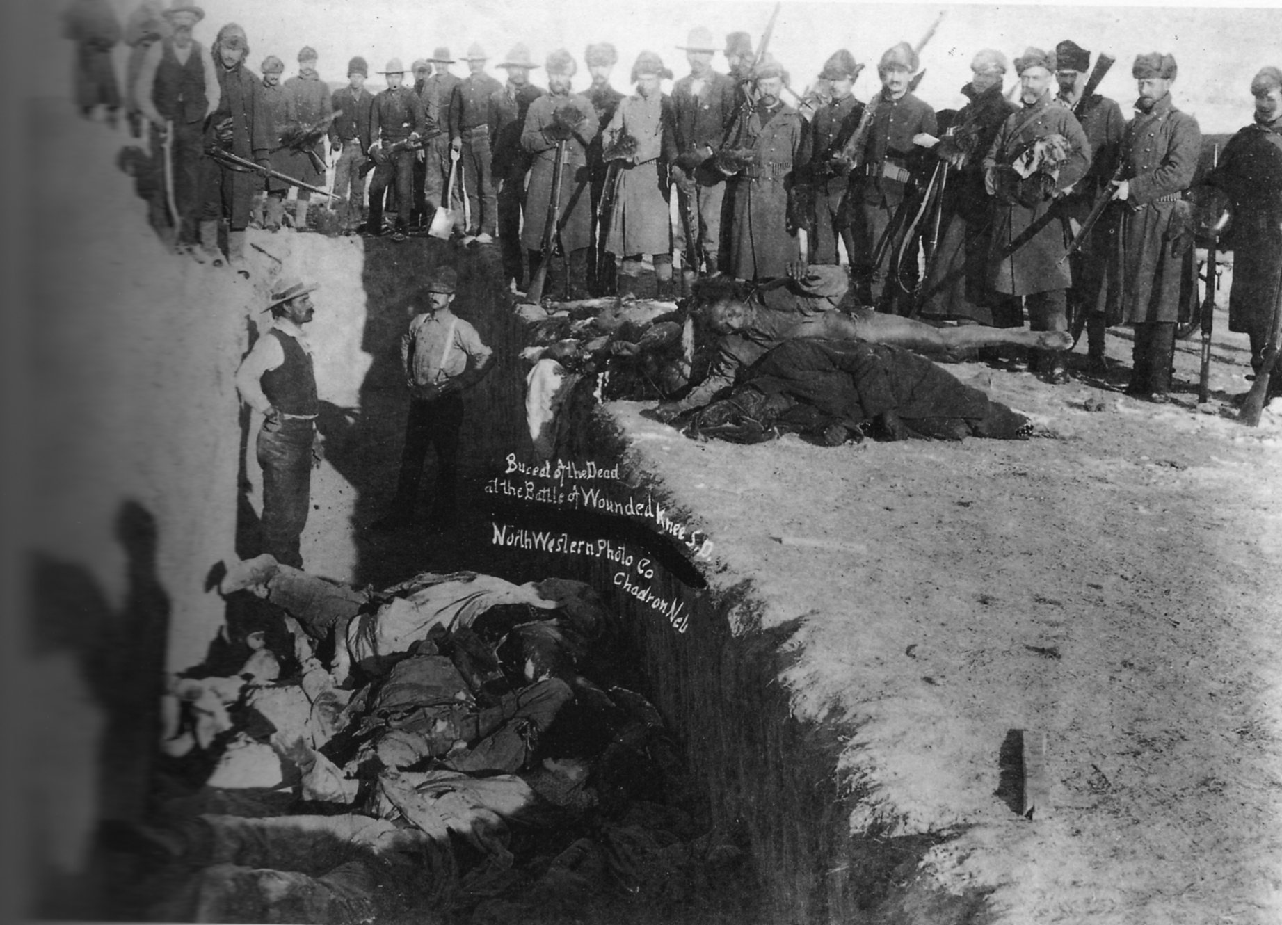 Burial of the dead after the massacre of Wounded Knee.