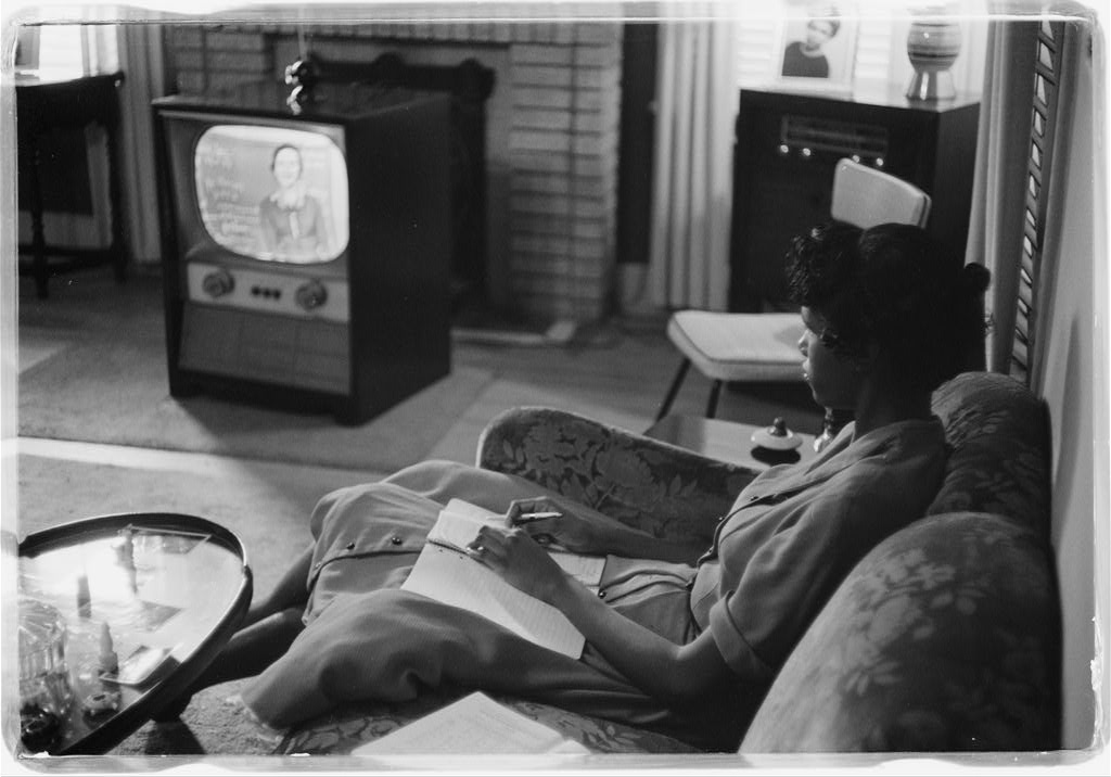 African American high school student being educated via television